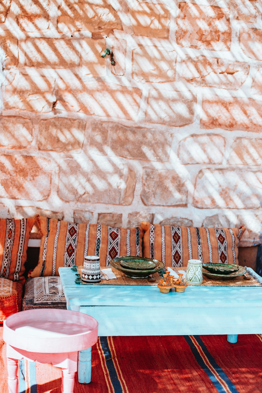 plates on coffee table beside sofa