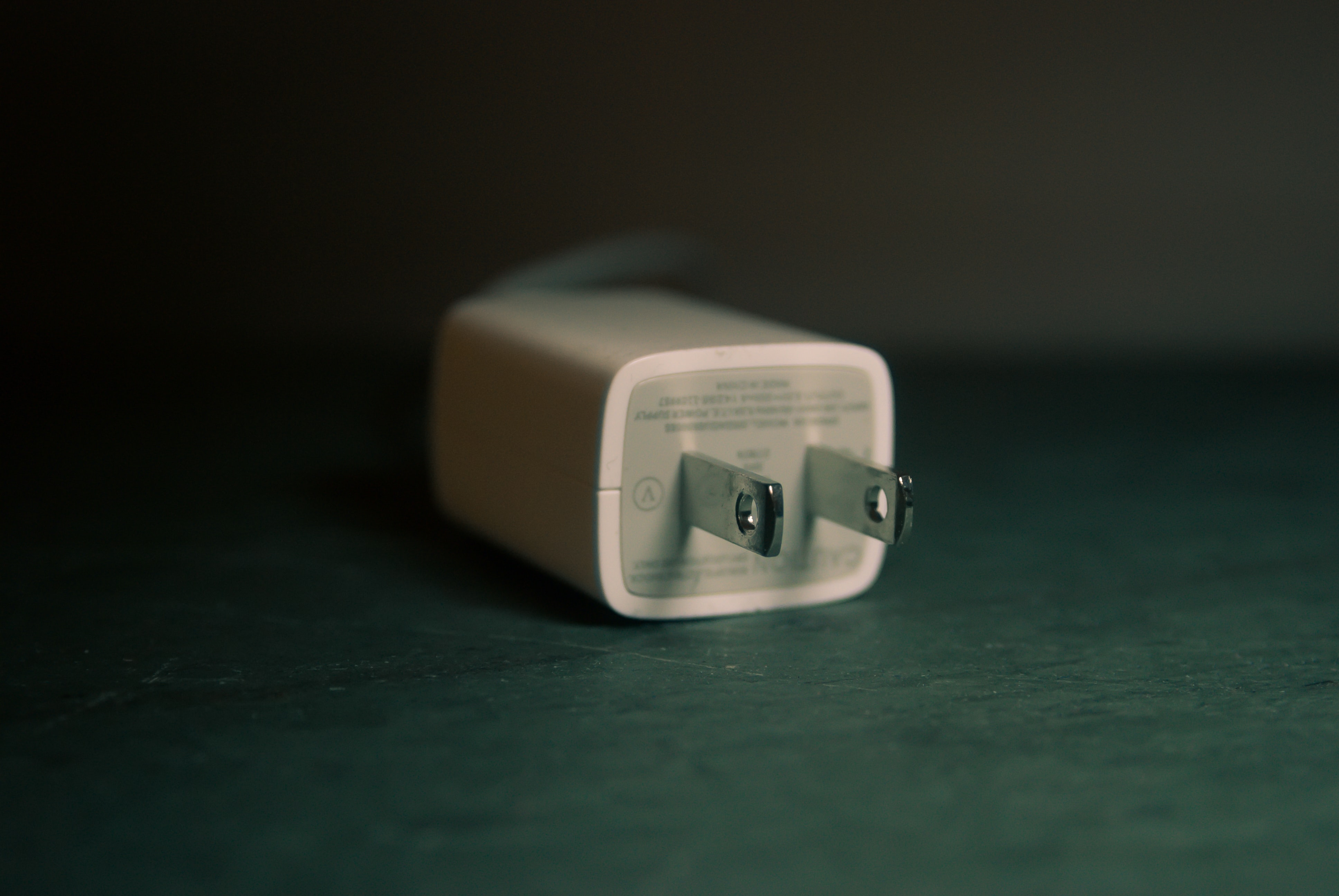 shallow focus photography of white travel adapter