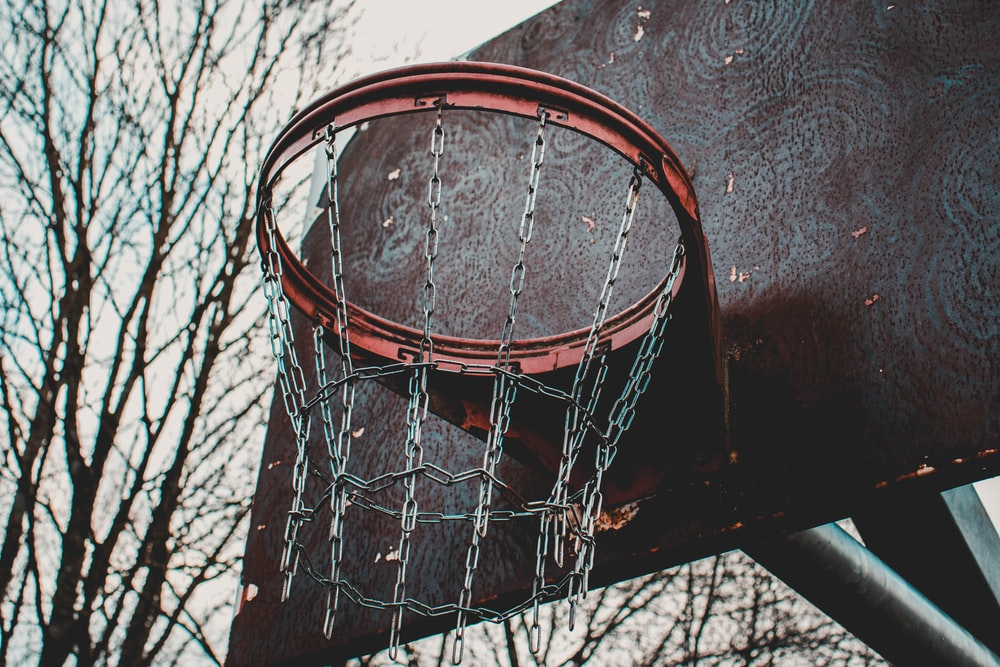 brown and red basketball ring shallow focus photography