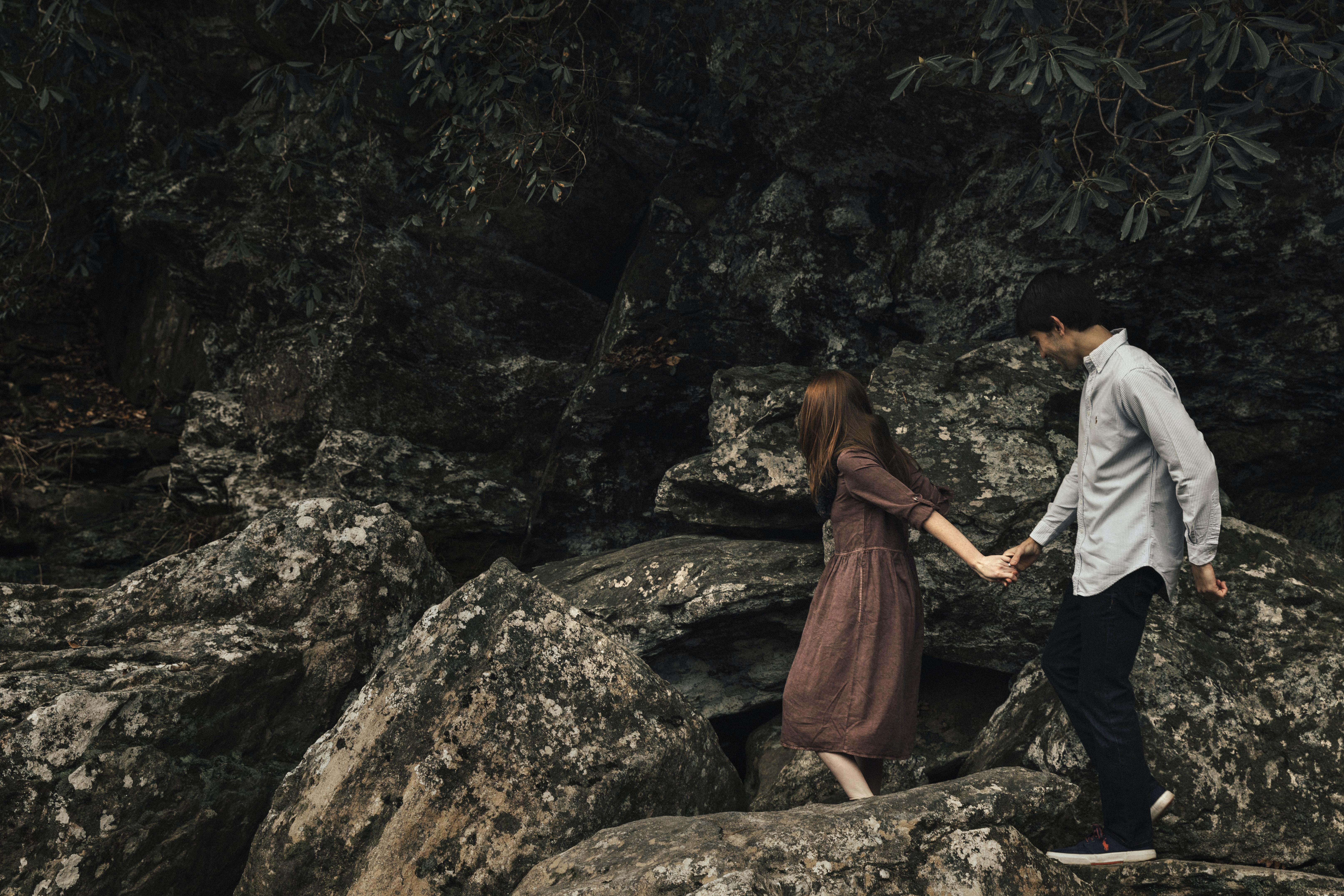 couple standing on rocky cliff
