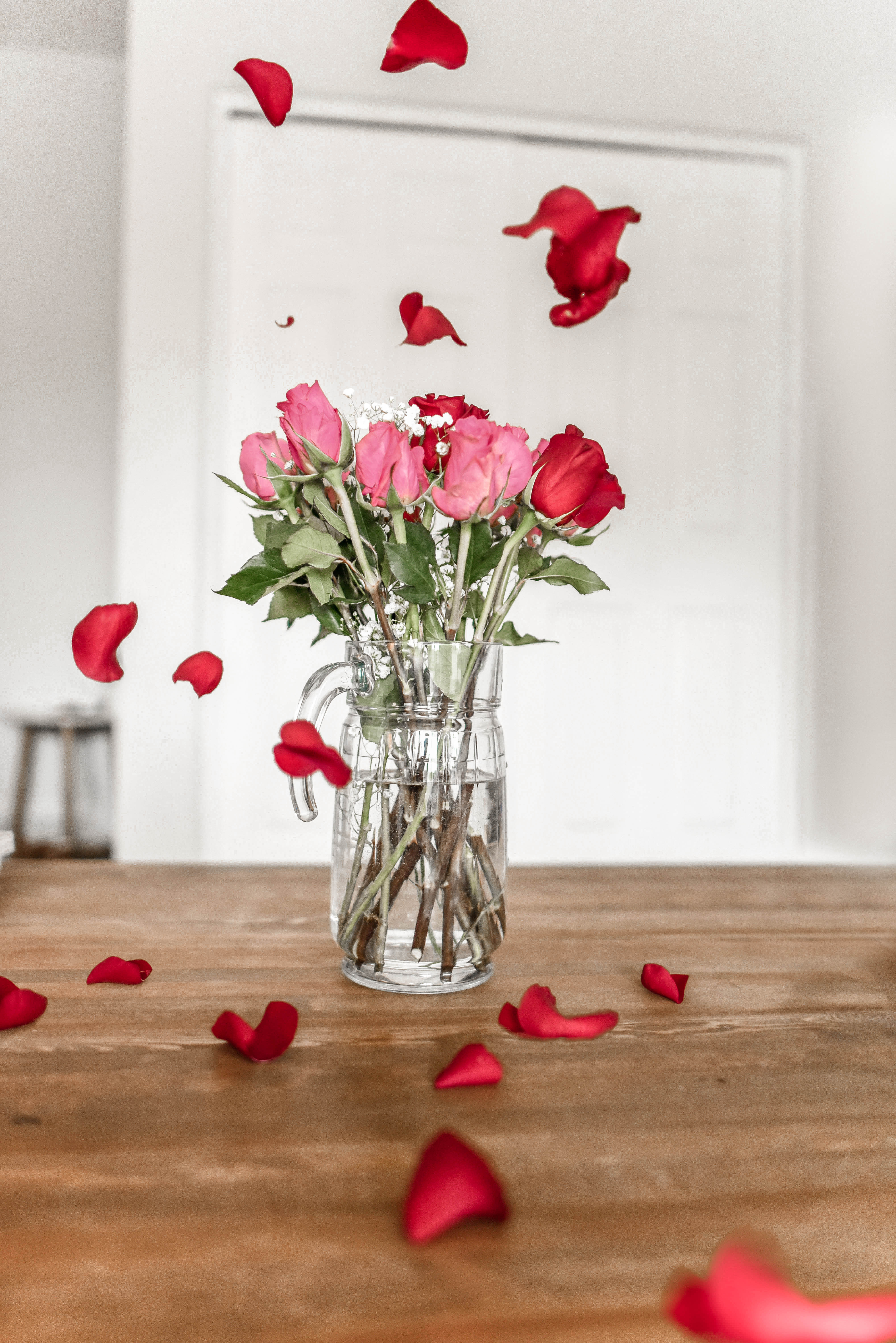 Pink And Red Roses On Clear Glvase