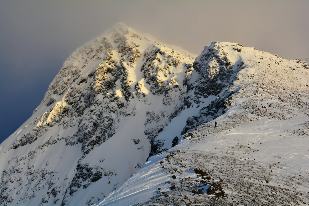 Climbing to the summit of South Suicide Peak during an unusually low-snow winter in southcentral Alaska.