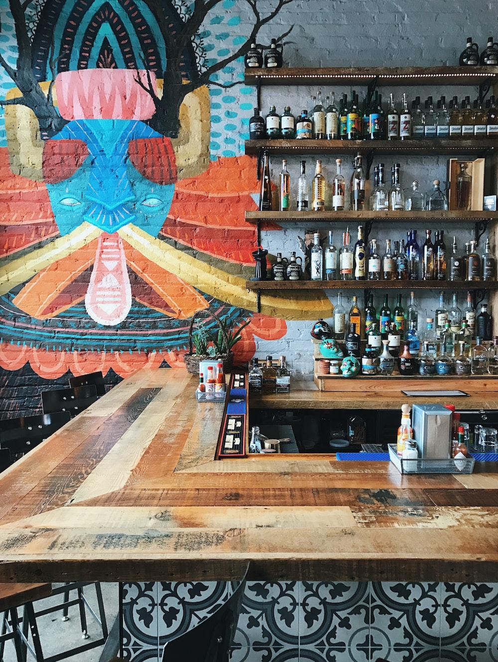 assorted bottles on wooden rack