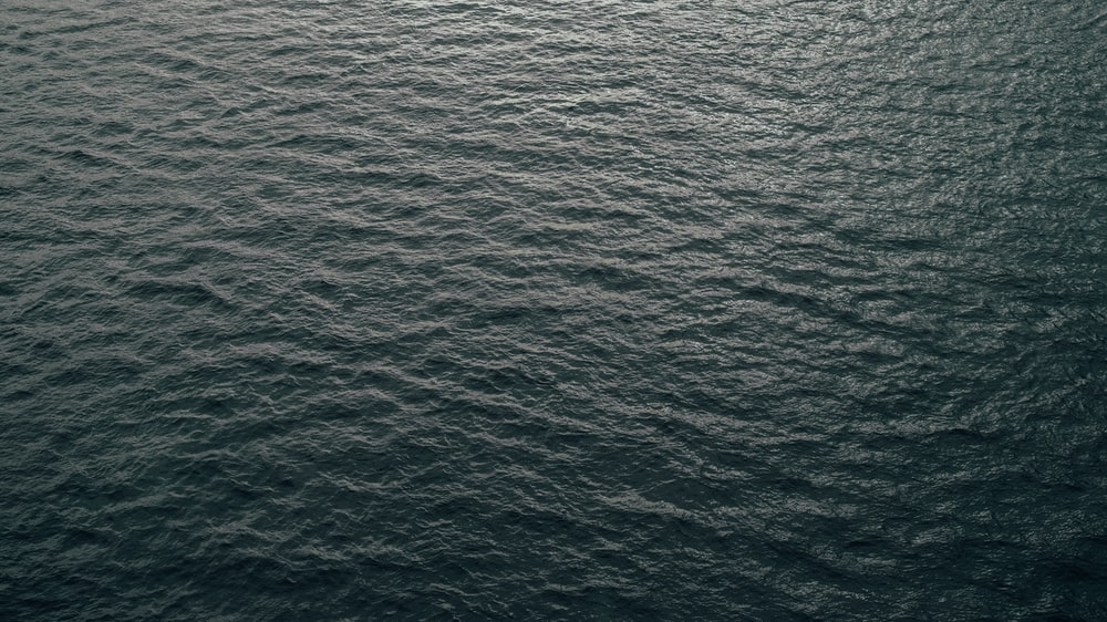 body of water with waves