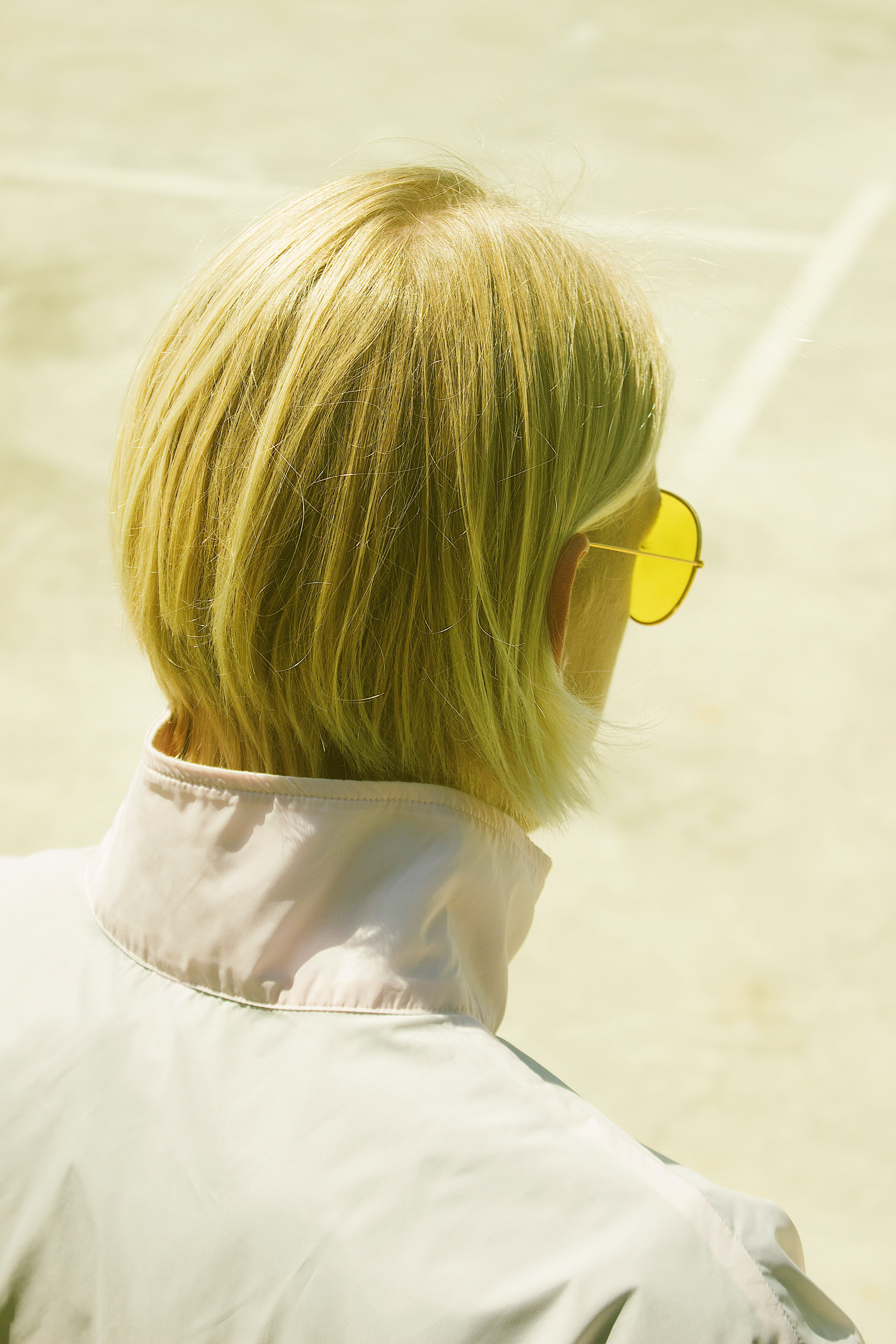person wearing yellow sunglasses