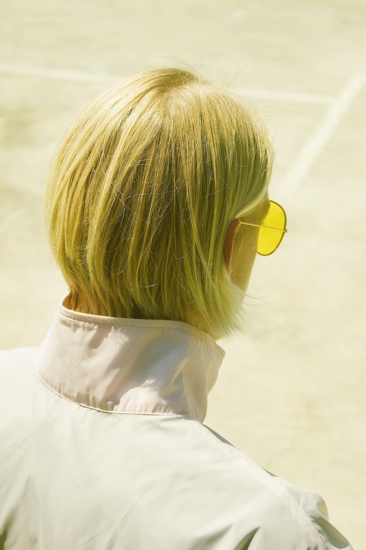 person wearing yellow sunglasses