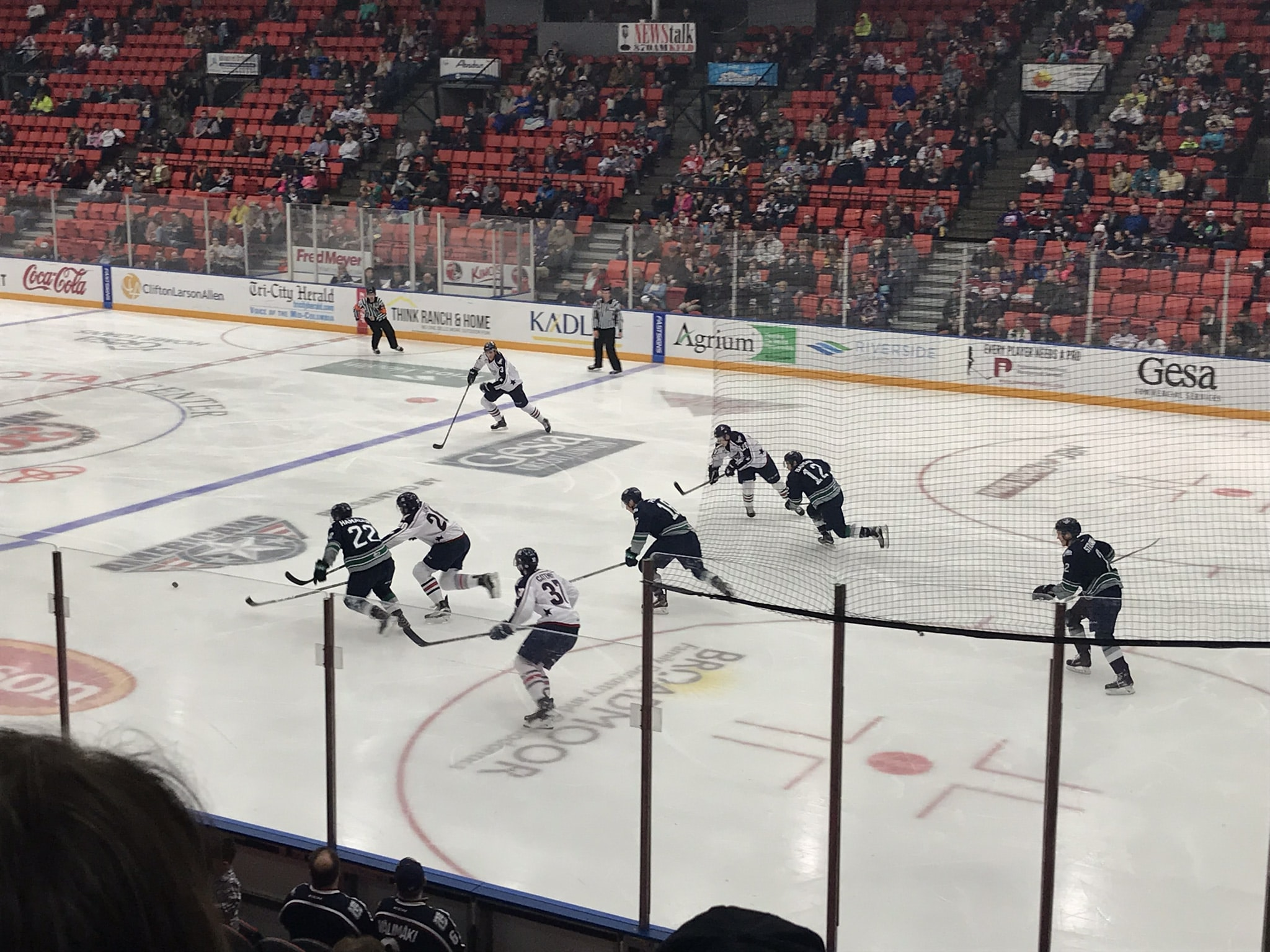 people playing ice hockey at the arena