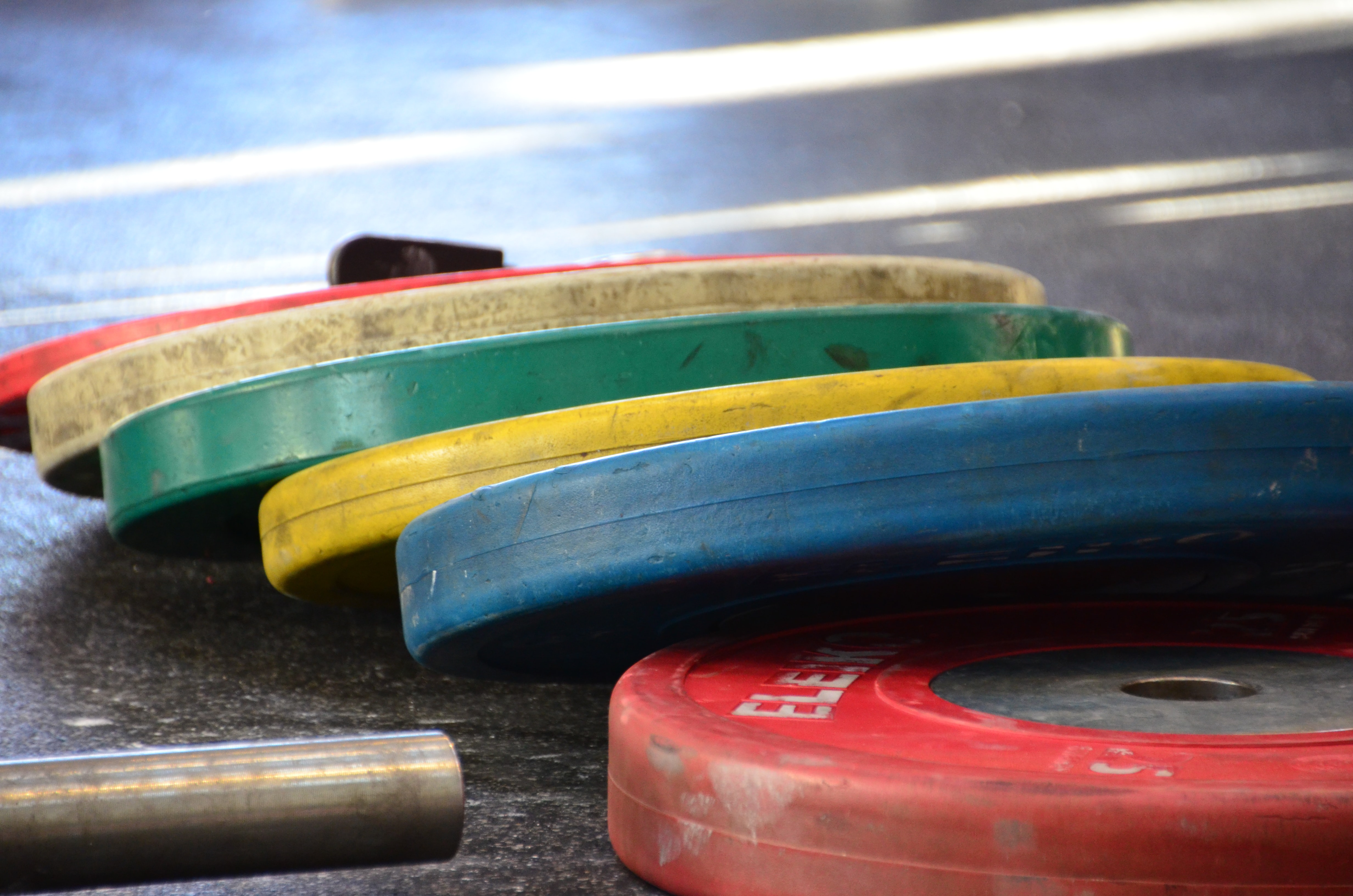 assorted-color barbell plates