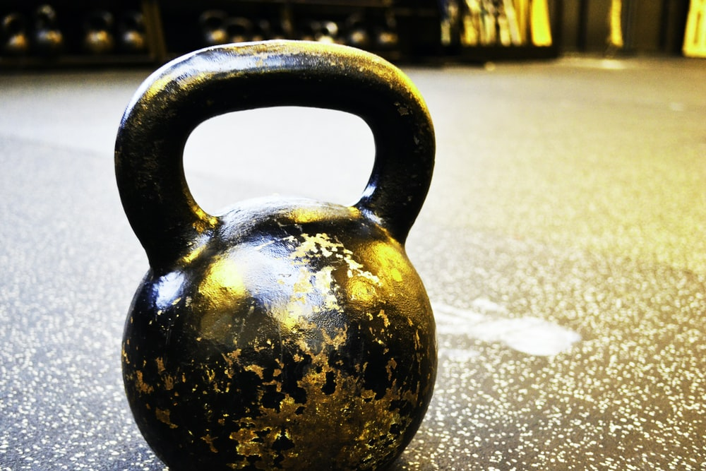black kettle bell on floor