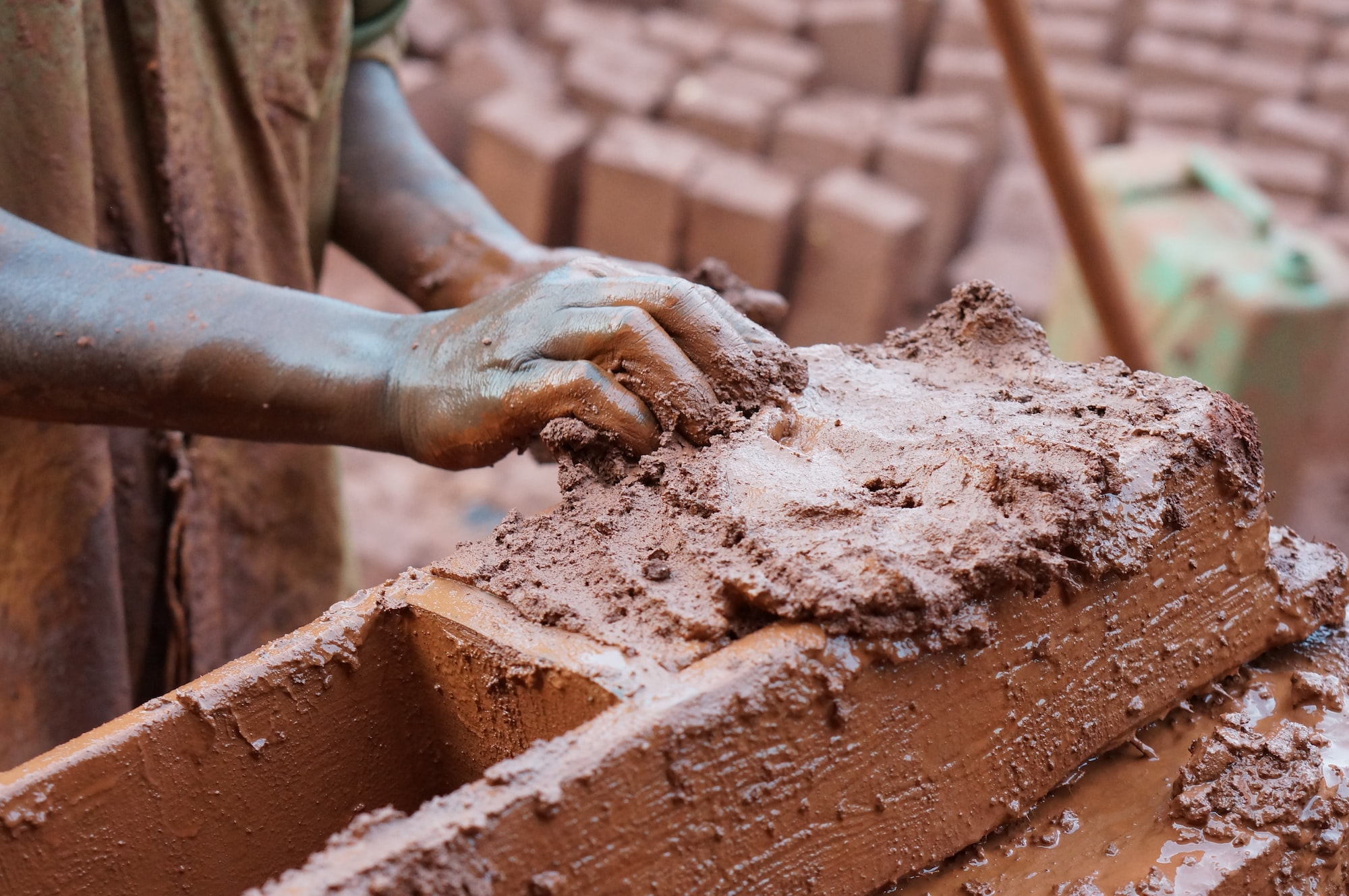 Was walking through the slums of Kampala and came across a brick maker, making clay bricks by hand. For more, visit esteban-castle.com or IG: @estebancastle_media