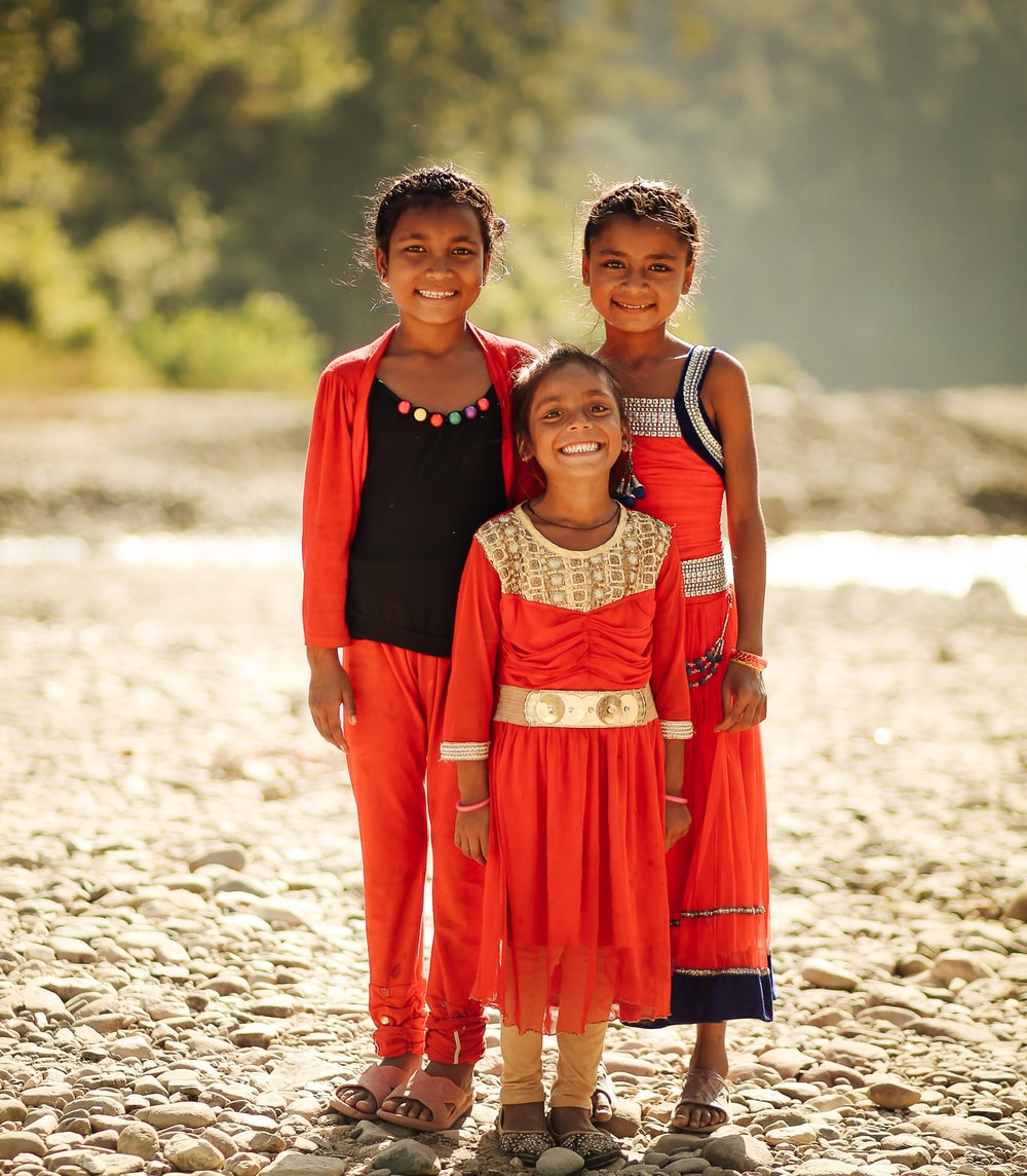 three toddler's in red clothes