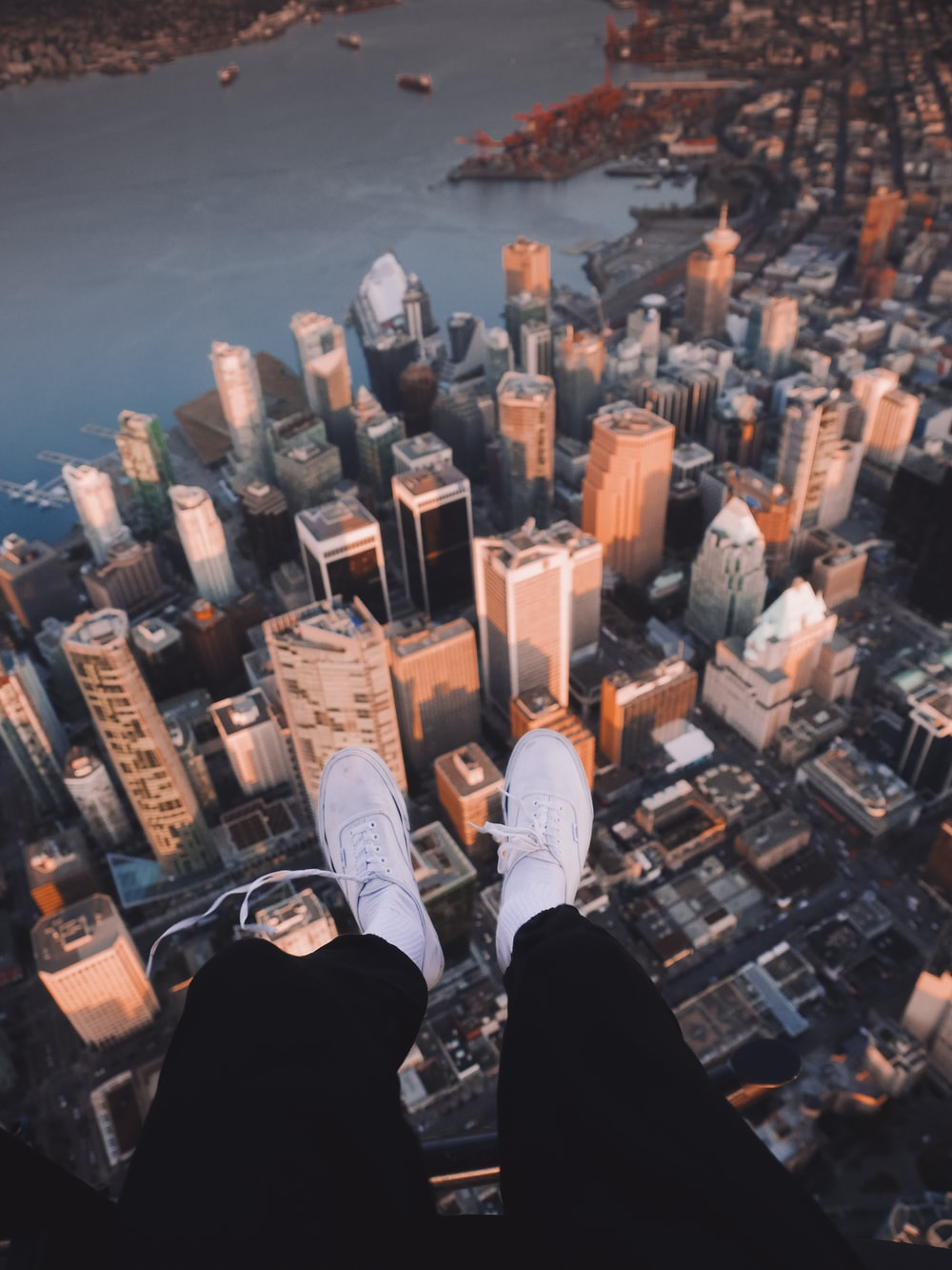 person's sitting on top of building