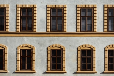 white and brown building liechtenstein teams background