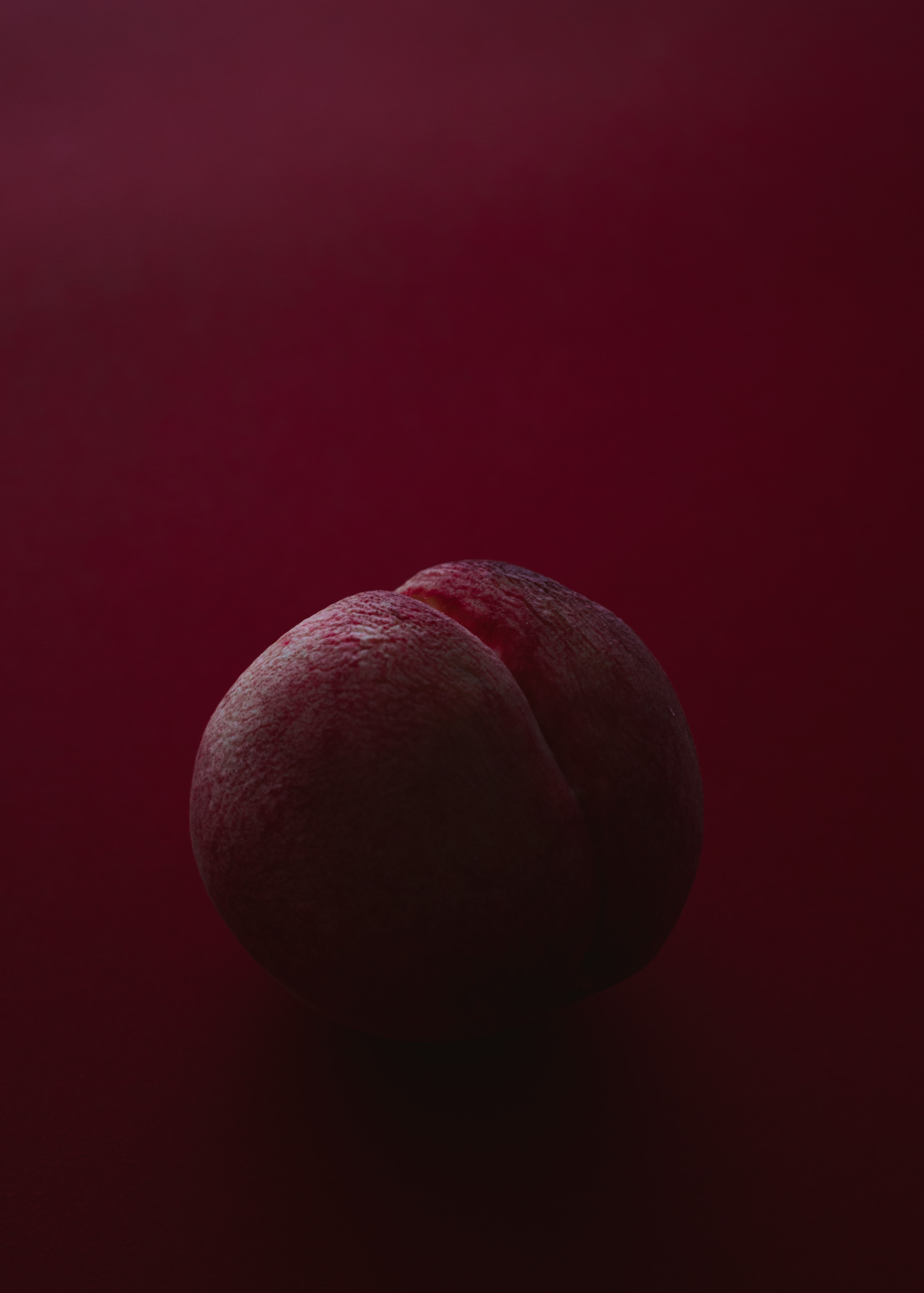 brown ball on red surface
