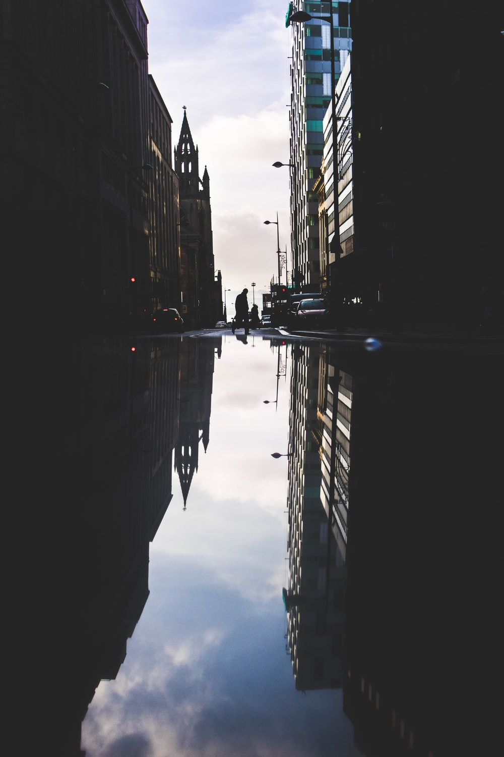 landscape photography of high-rise buildings with reflection on the water