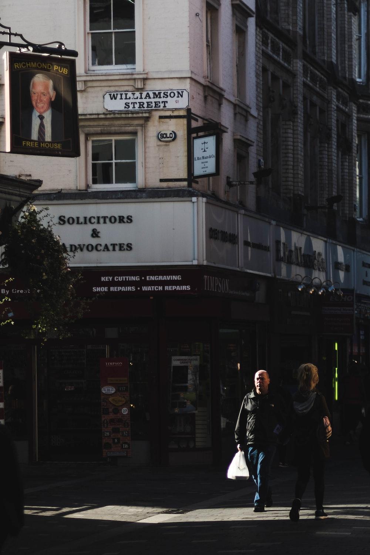 man and woman walking on Willliamson Street