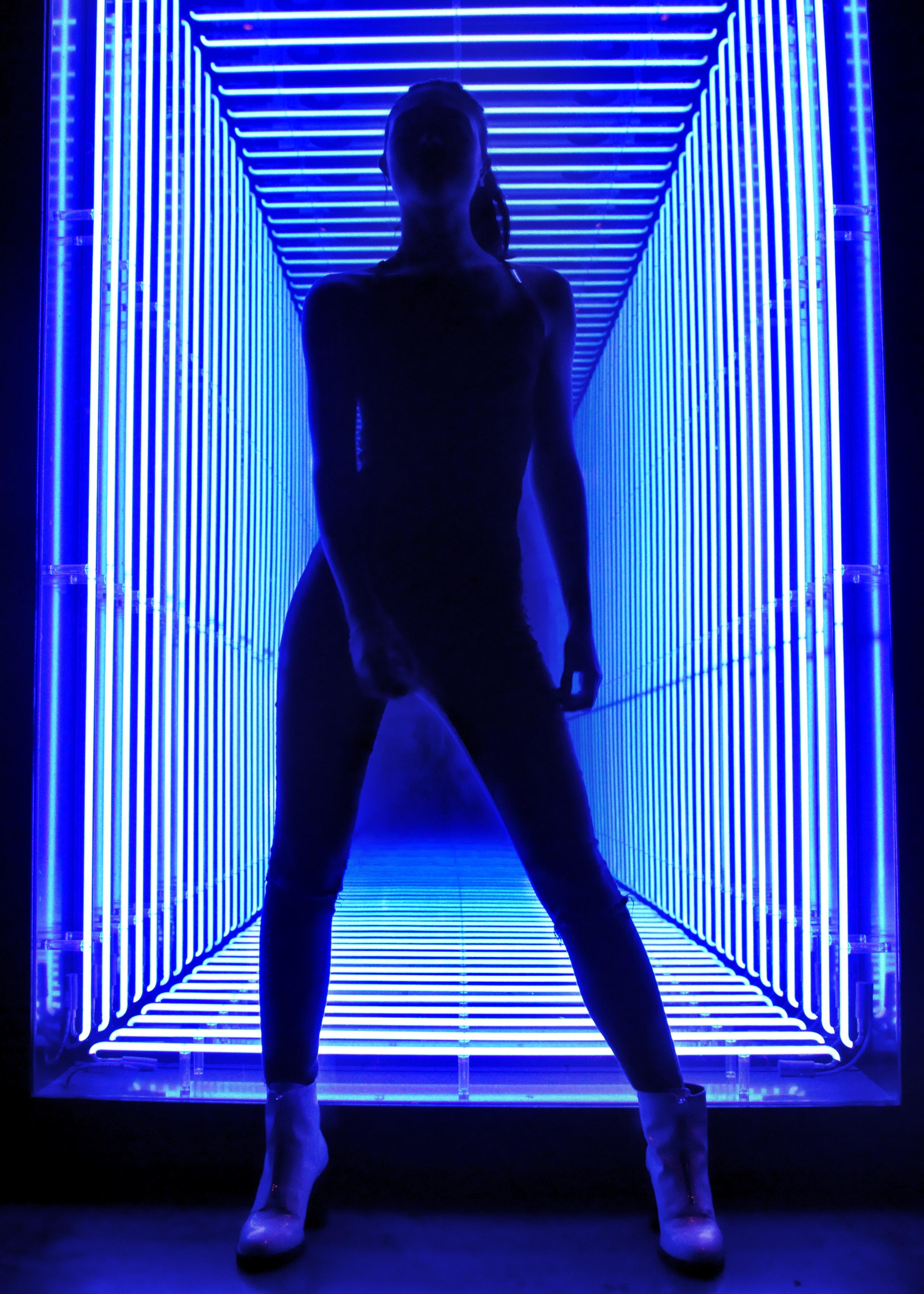 woman standing near lights