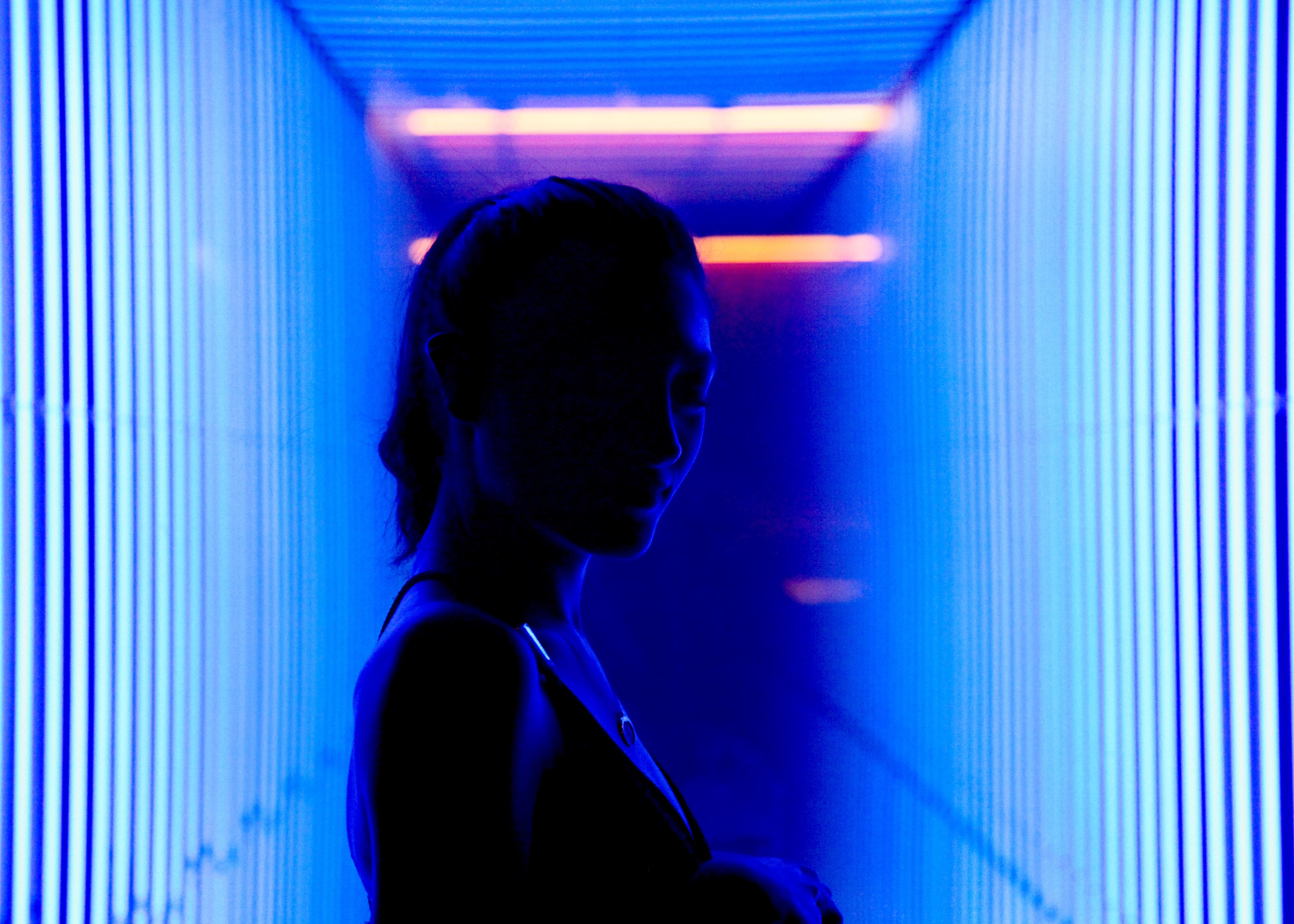 woman between blue lights