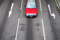 car traversing road at daytime