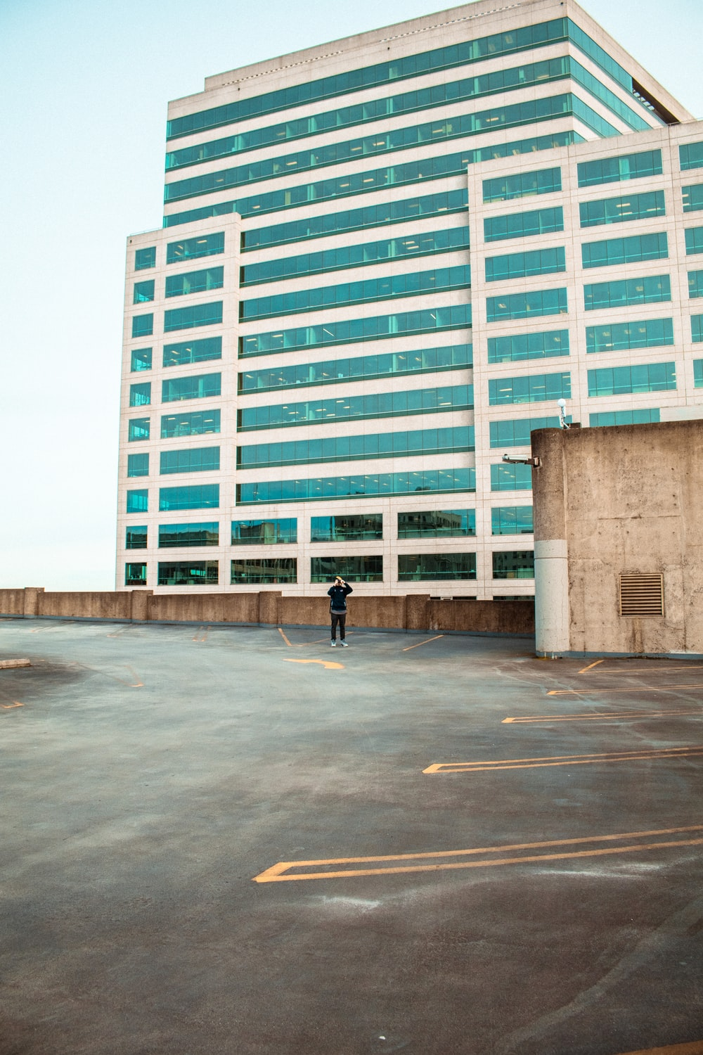 person standing on building roof top