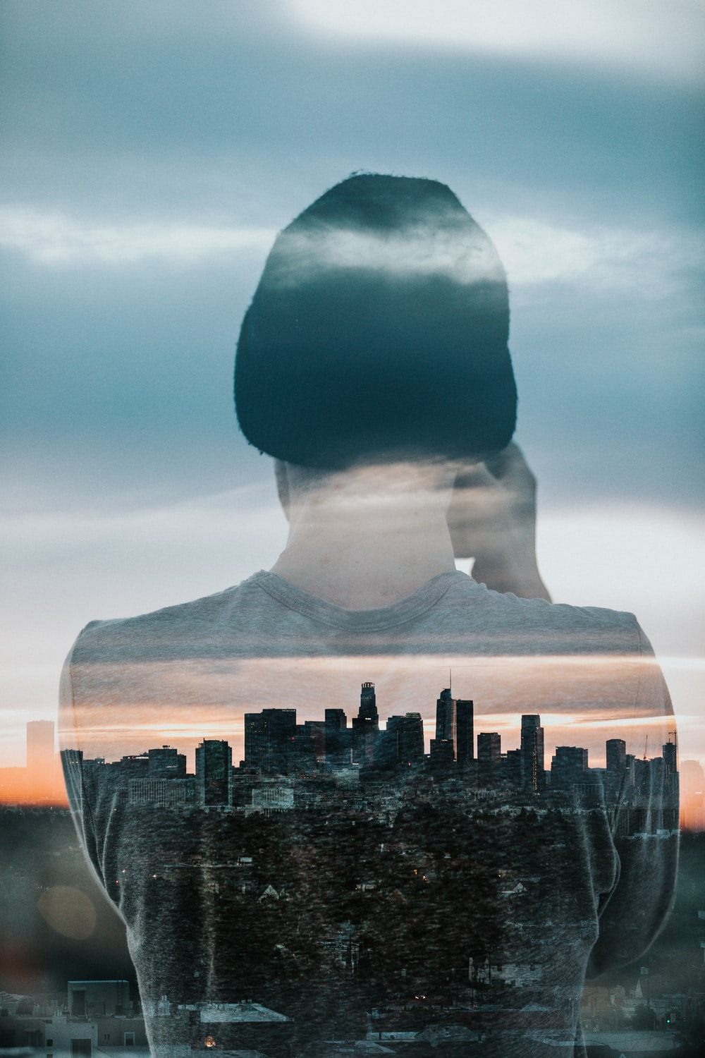 back view of person with cityscape view