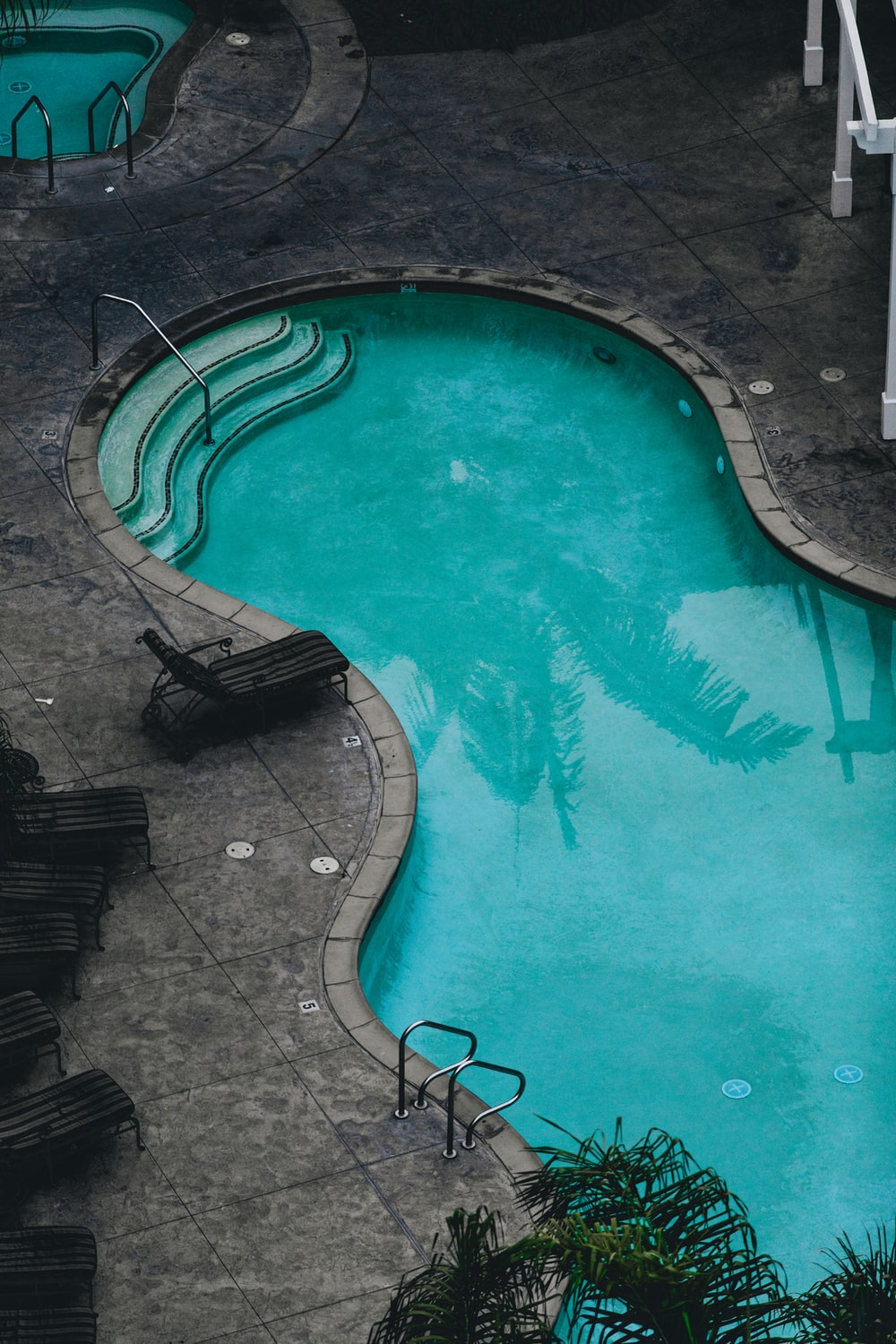 swimming pool during daytime in aerial view photography