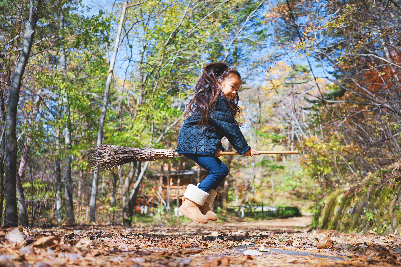 girl riding broom stick