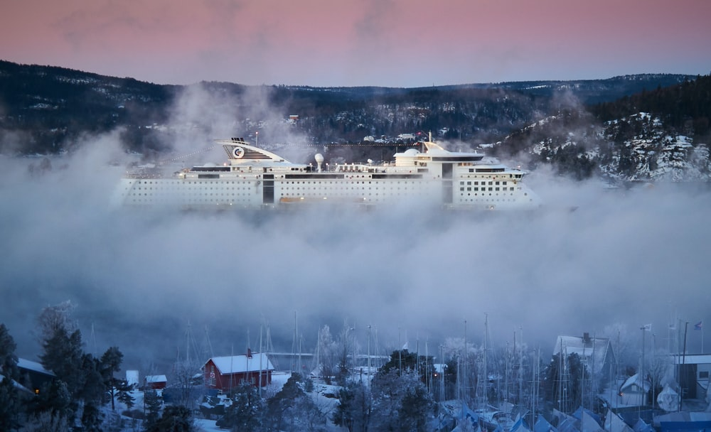 white building covered with fog