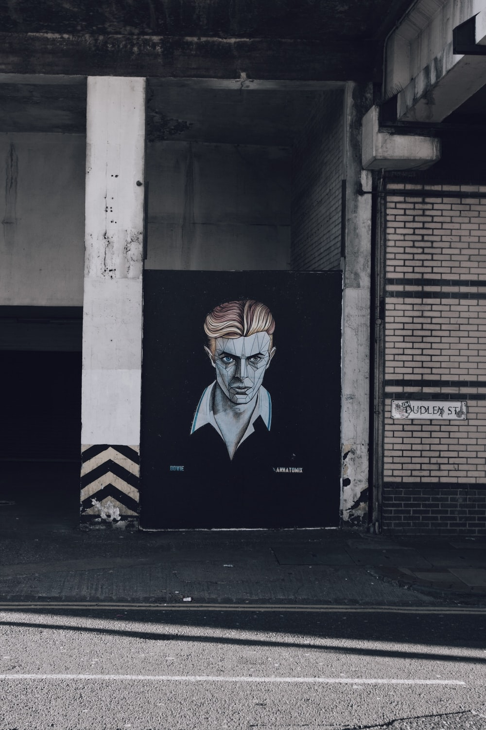 man portrait painting between wall