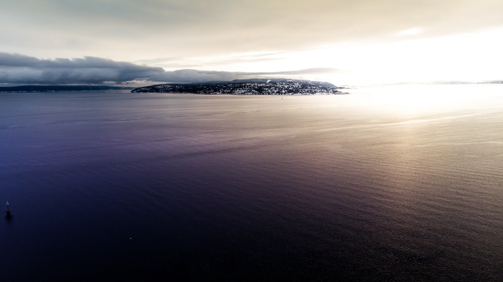 panoramic photography of island in ocean