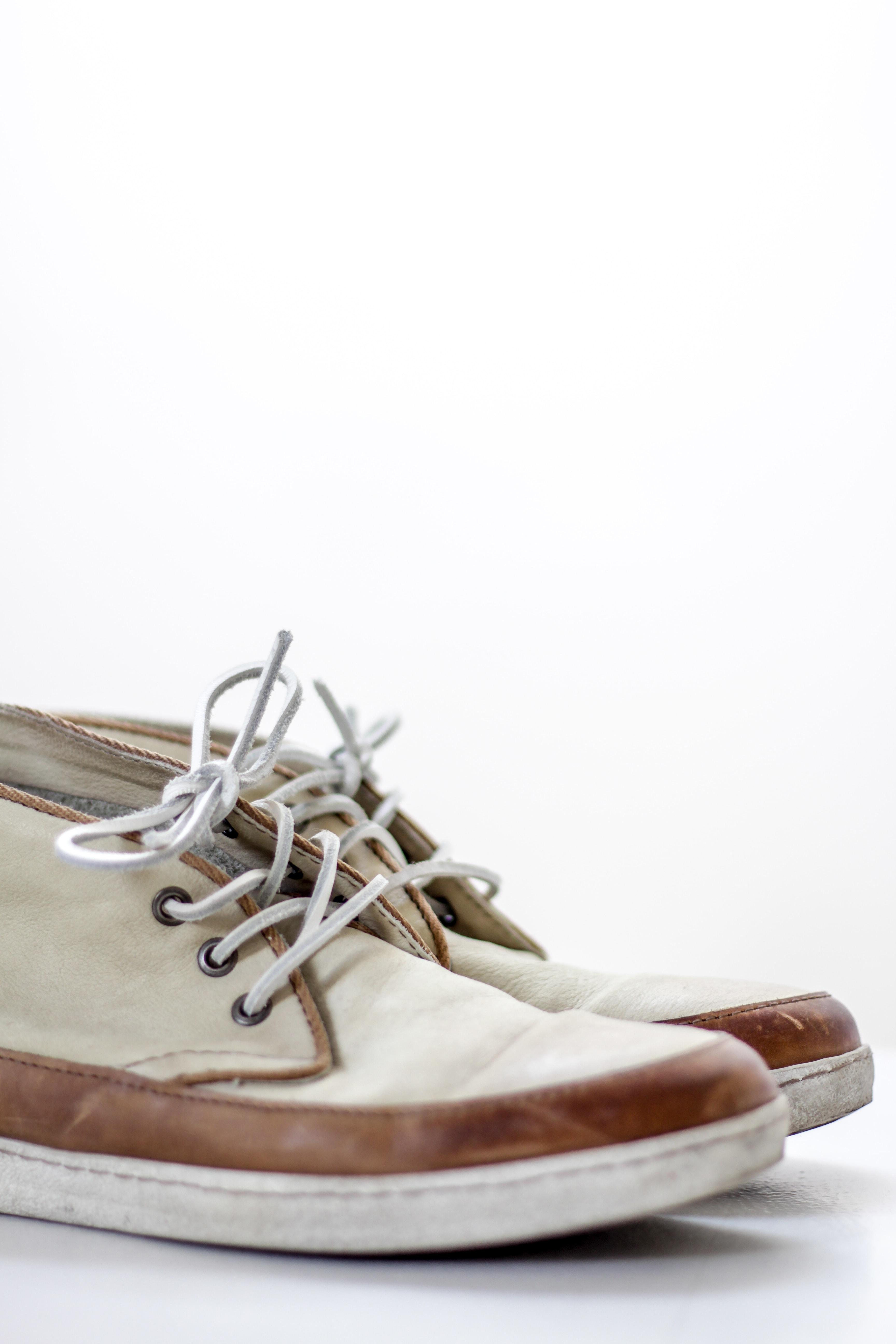 pair of beige chukka boots