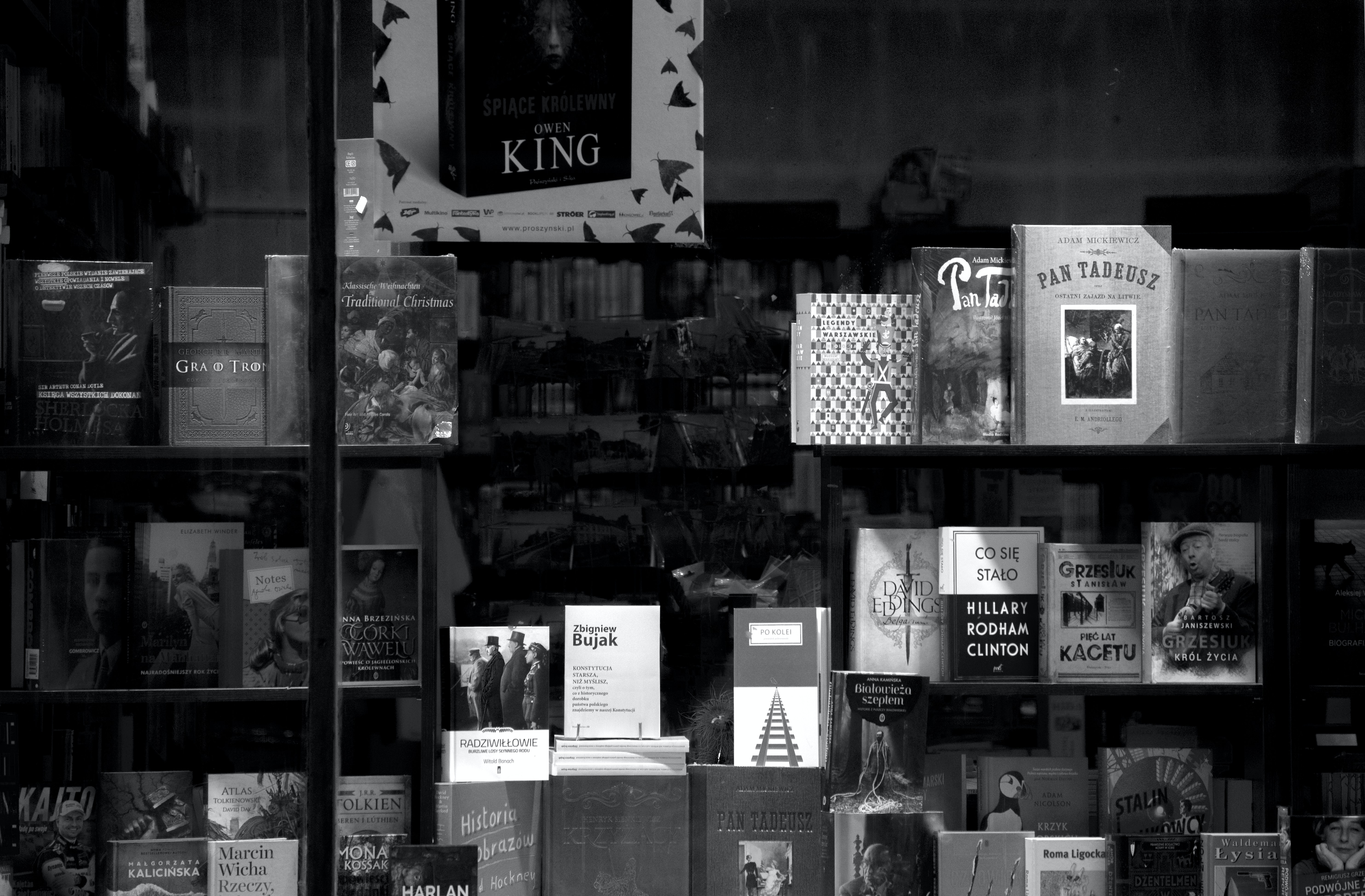 grayscale photo of assorted books