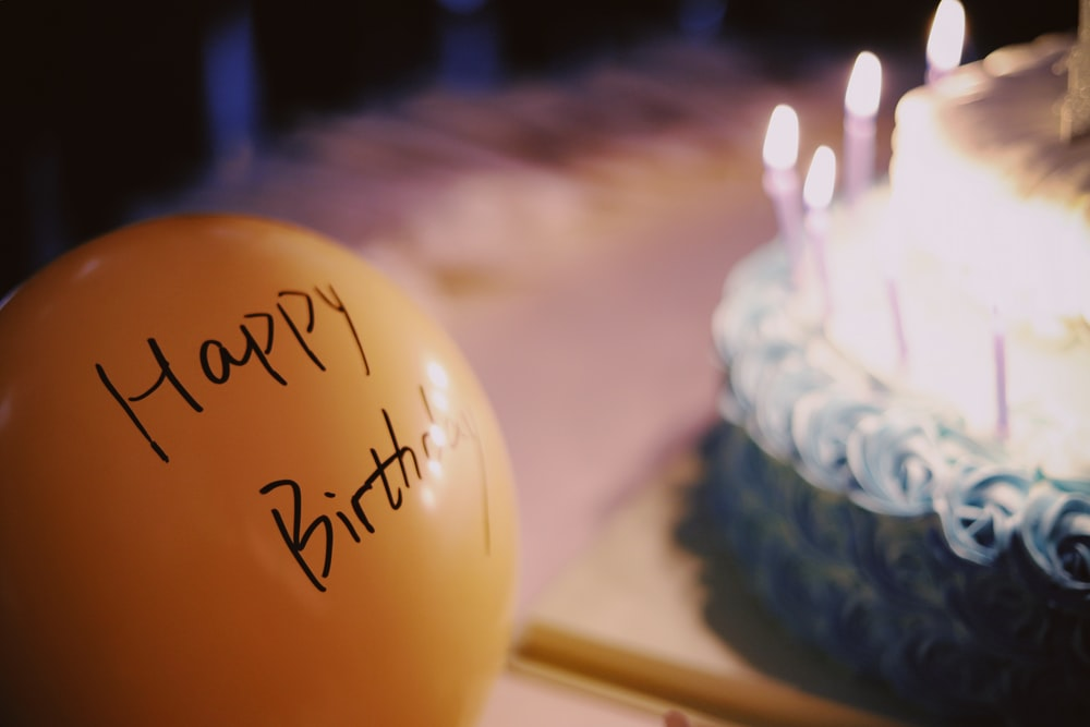 yellow balloon near cake