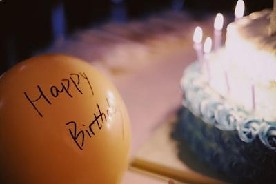 yellow balloon near cake happy birthday zoom background