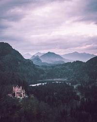 castle on mountain near body of water