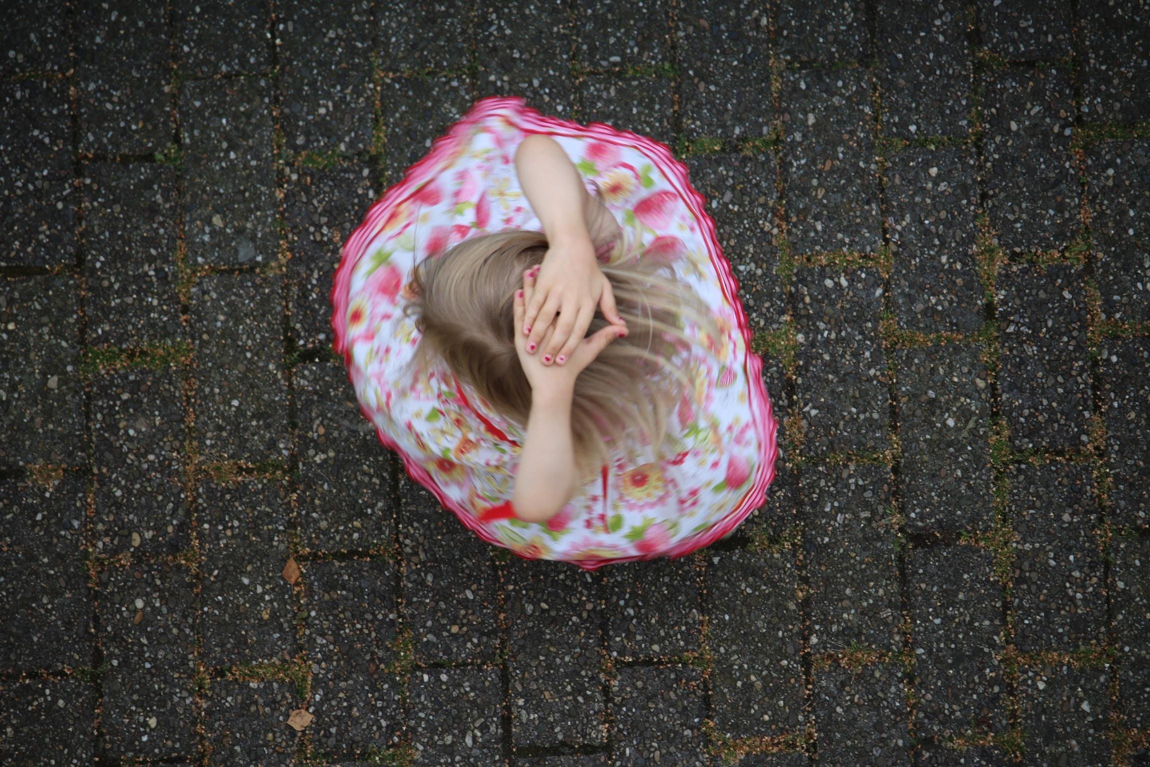 girl sitting on ground