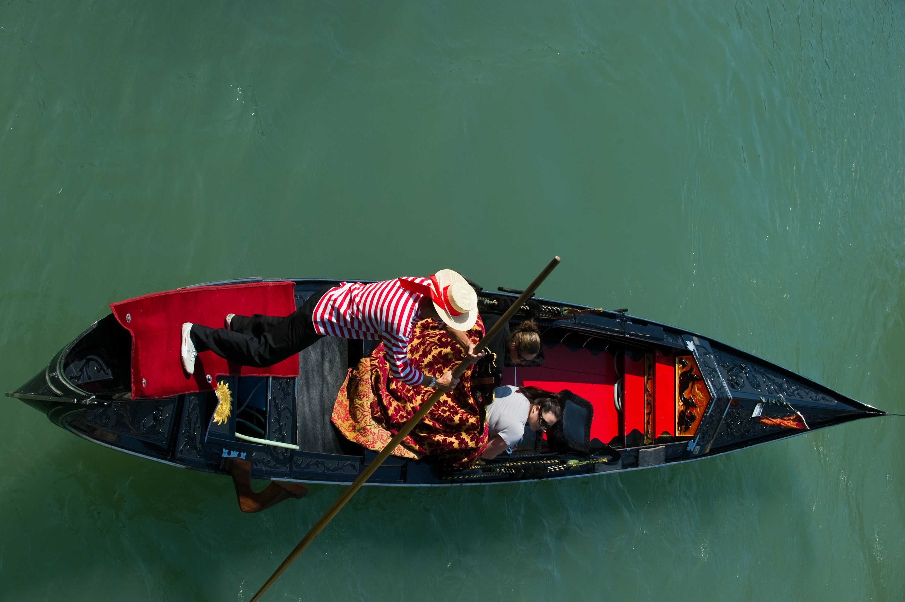 two men riding boat on body of water during day