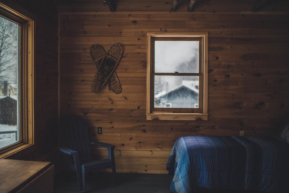 empty bed beside closed window