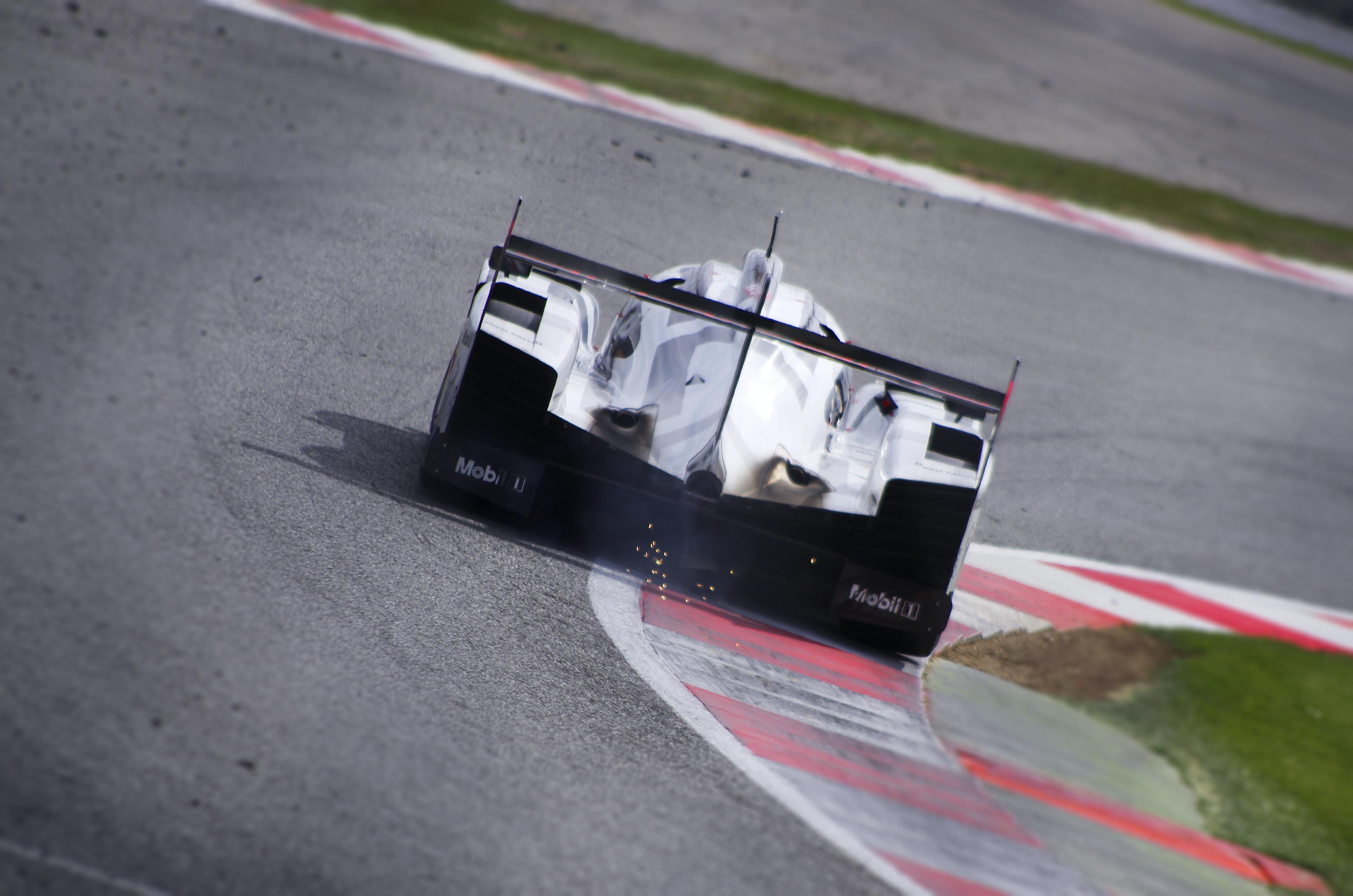 white racing car drifting