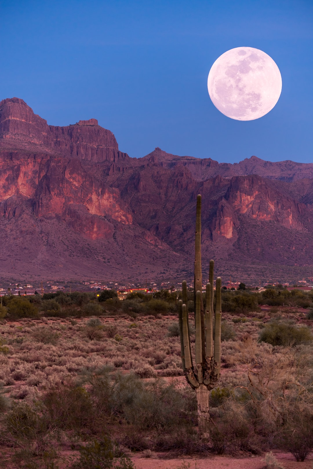 End of the golden hour and start of the Lunar hour as the Full moon rises over the Superstitions overlooking Apache Junction