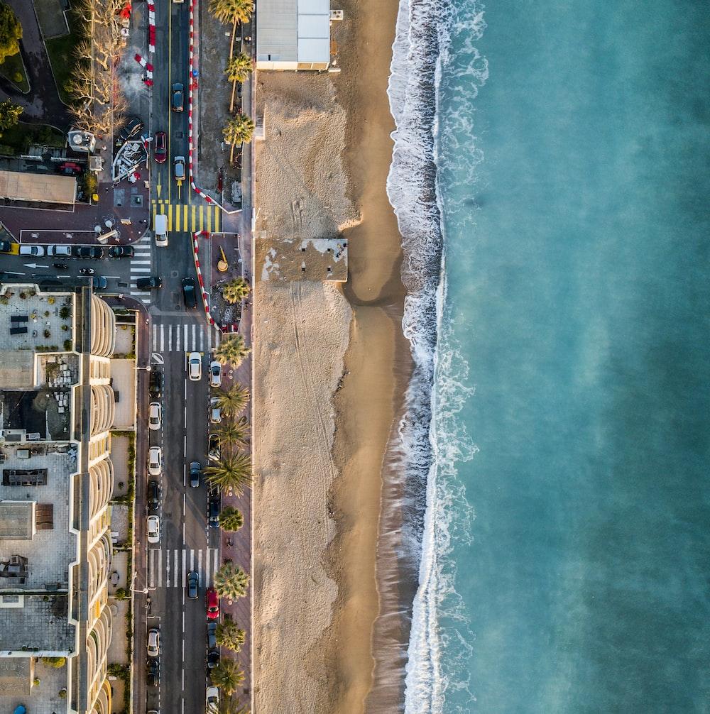 aerial photography of seashore near city at daytime