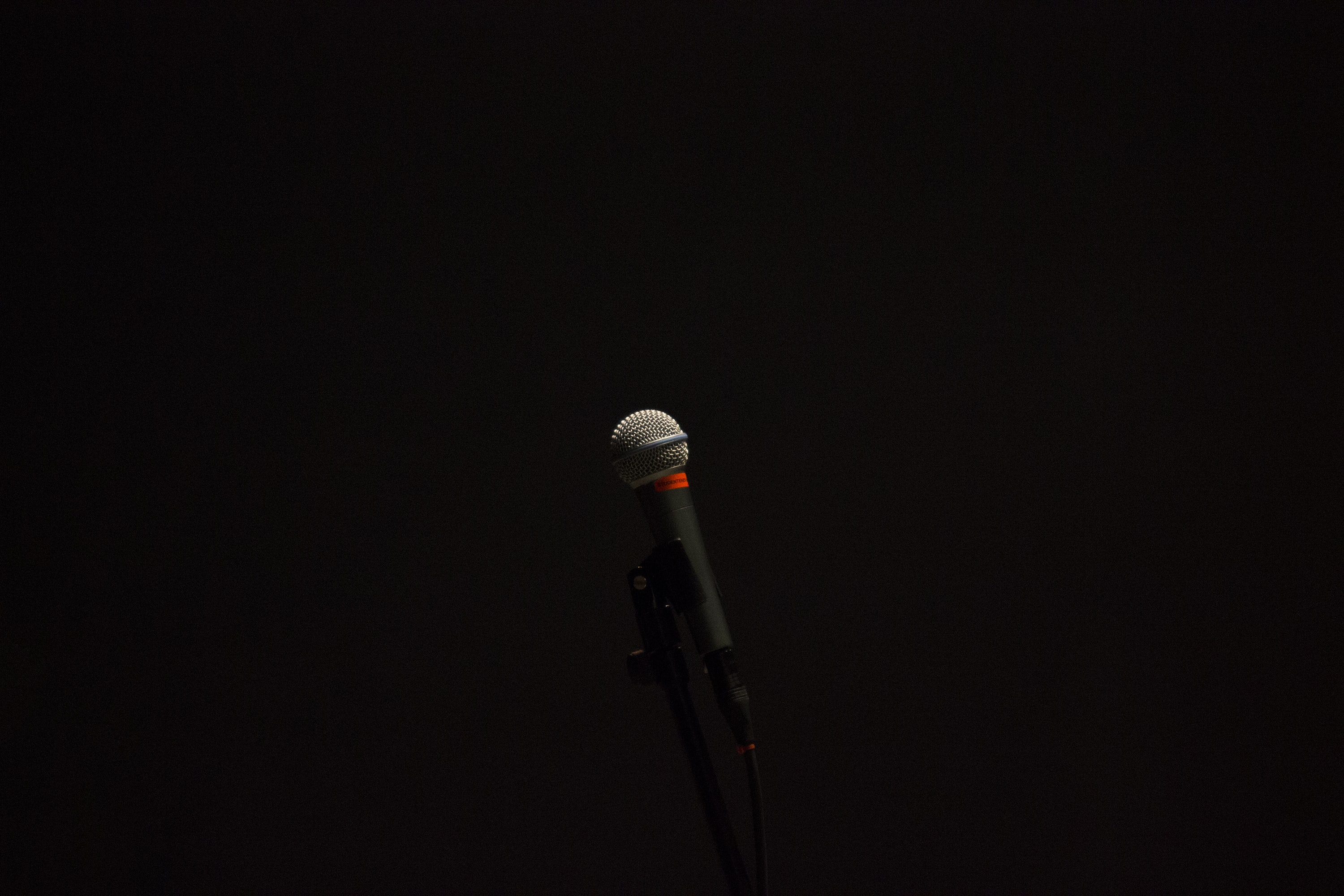 black corded microphone with stand