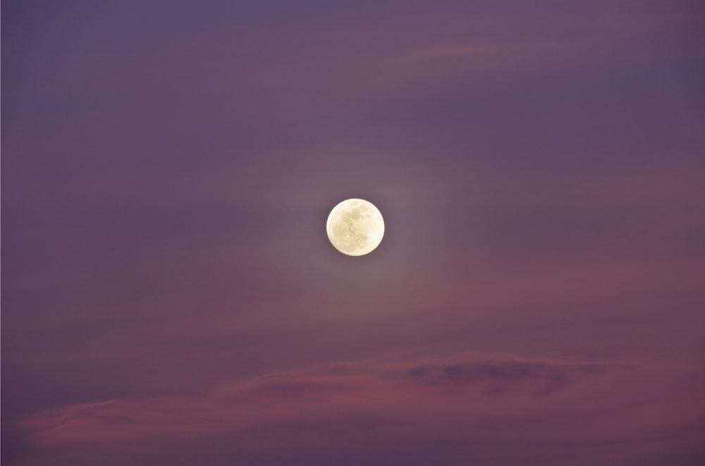 full moon on purple sky