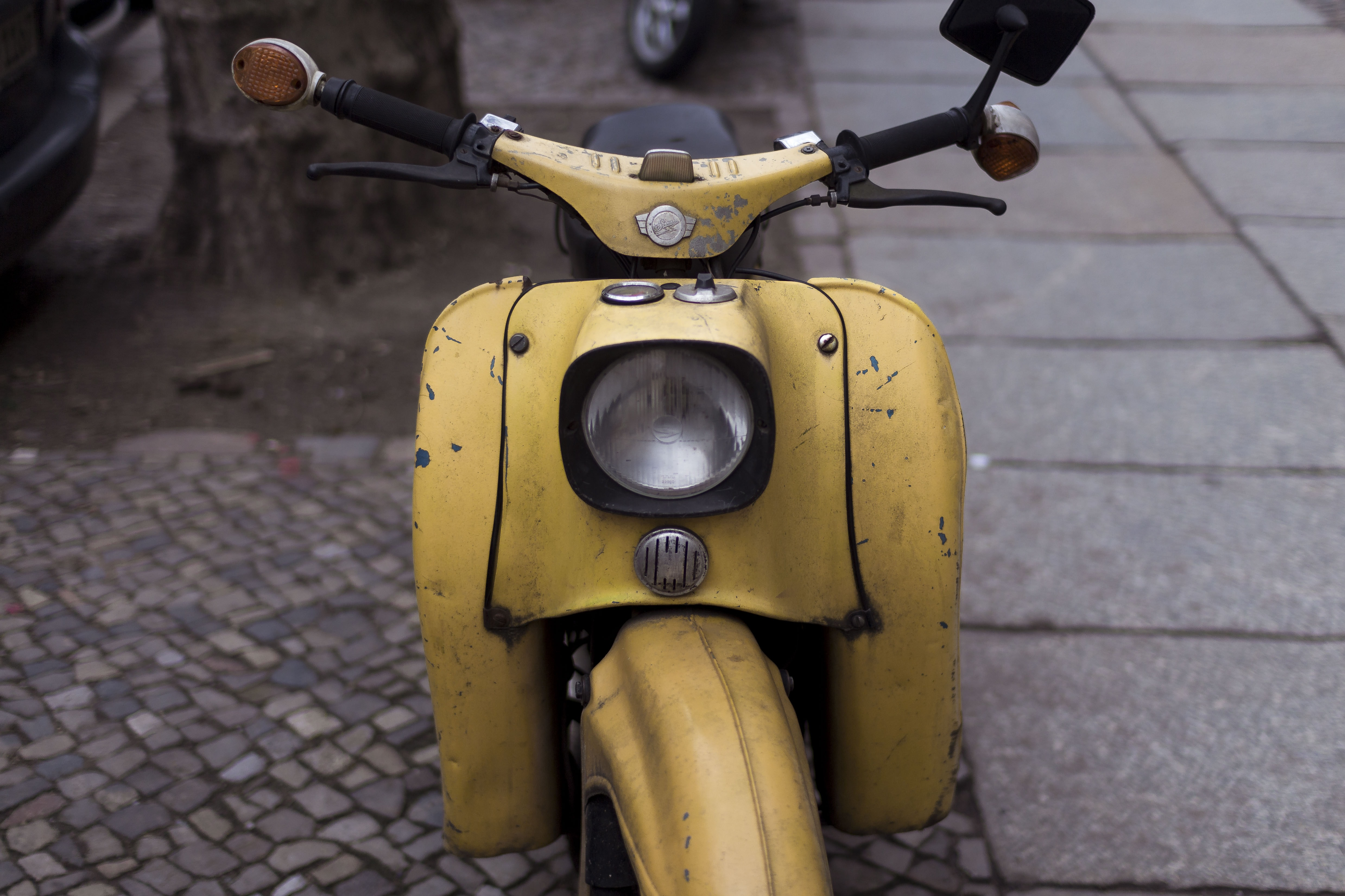 closeup photo of yellow motor scooter