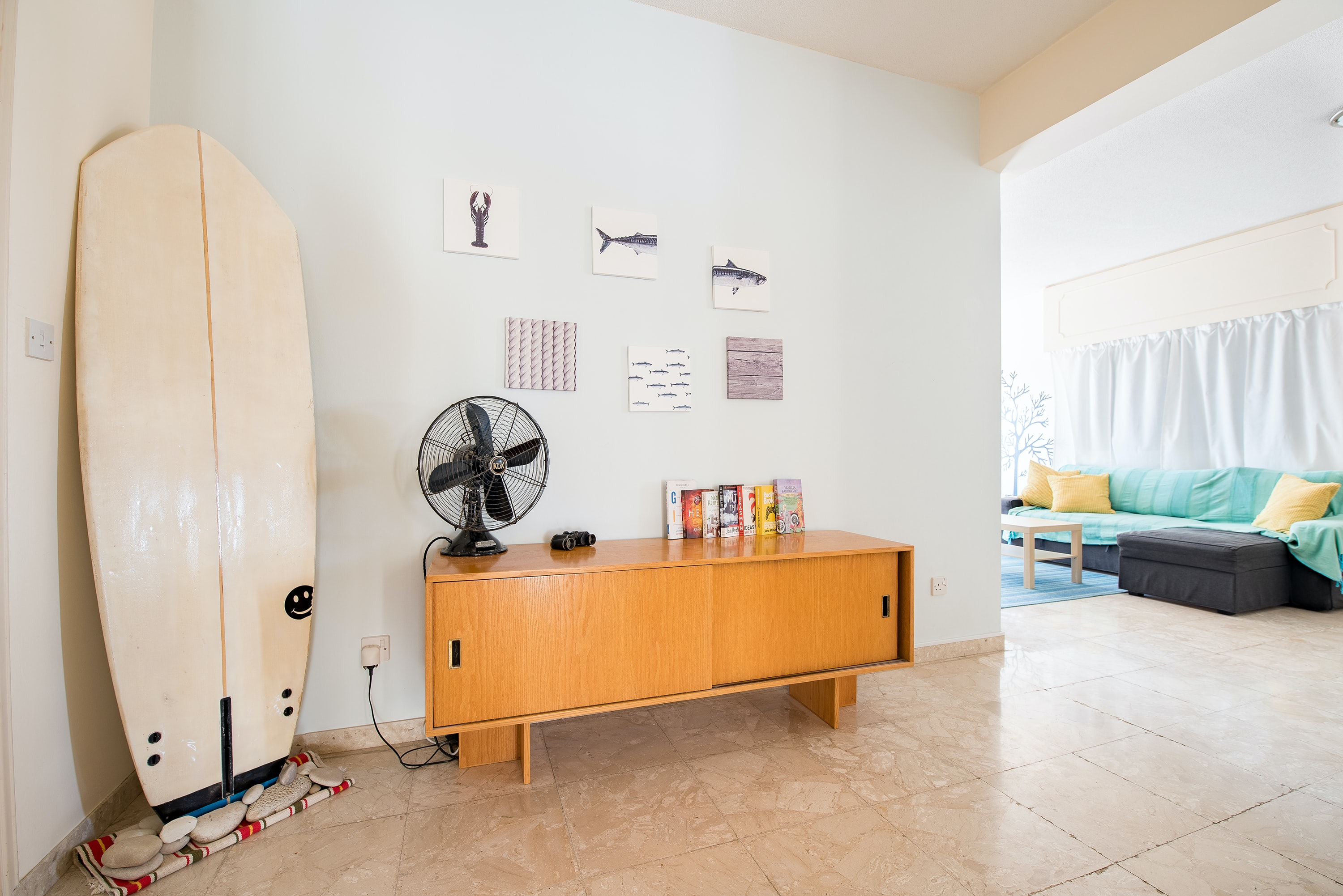 desk fan on credenza beside wall