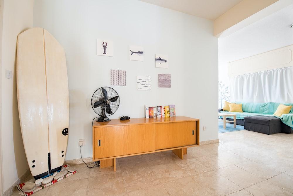 desk fan on credenza beside wall
