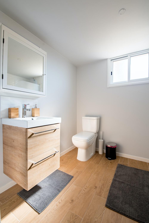 white ceramic toilet bowl near vanity combo