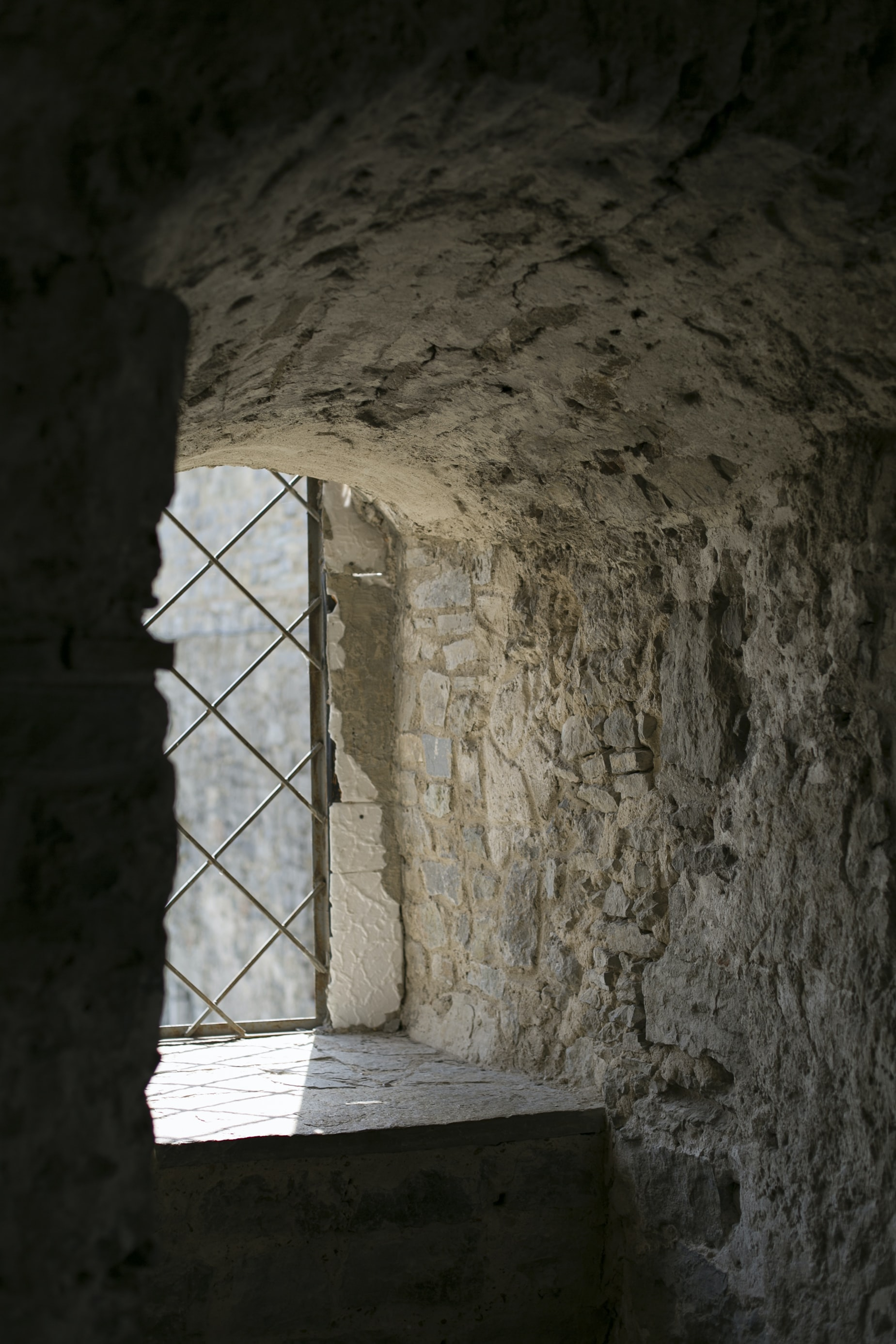 photo of rock house near window