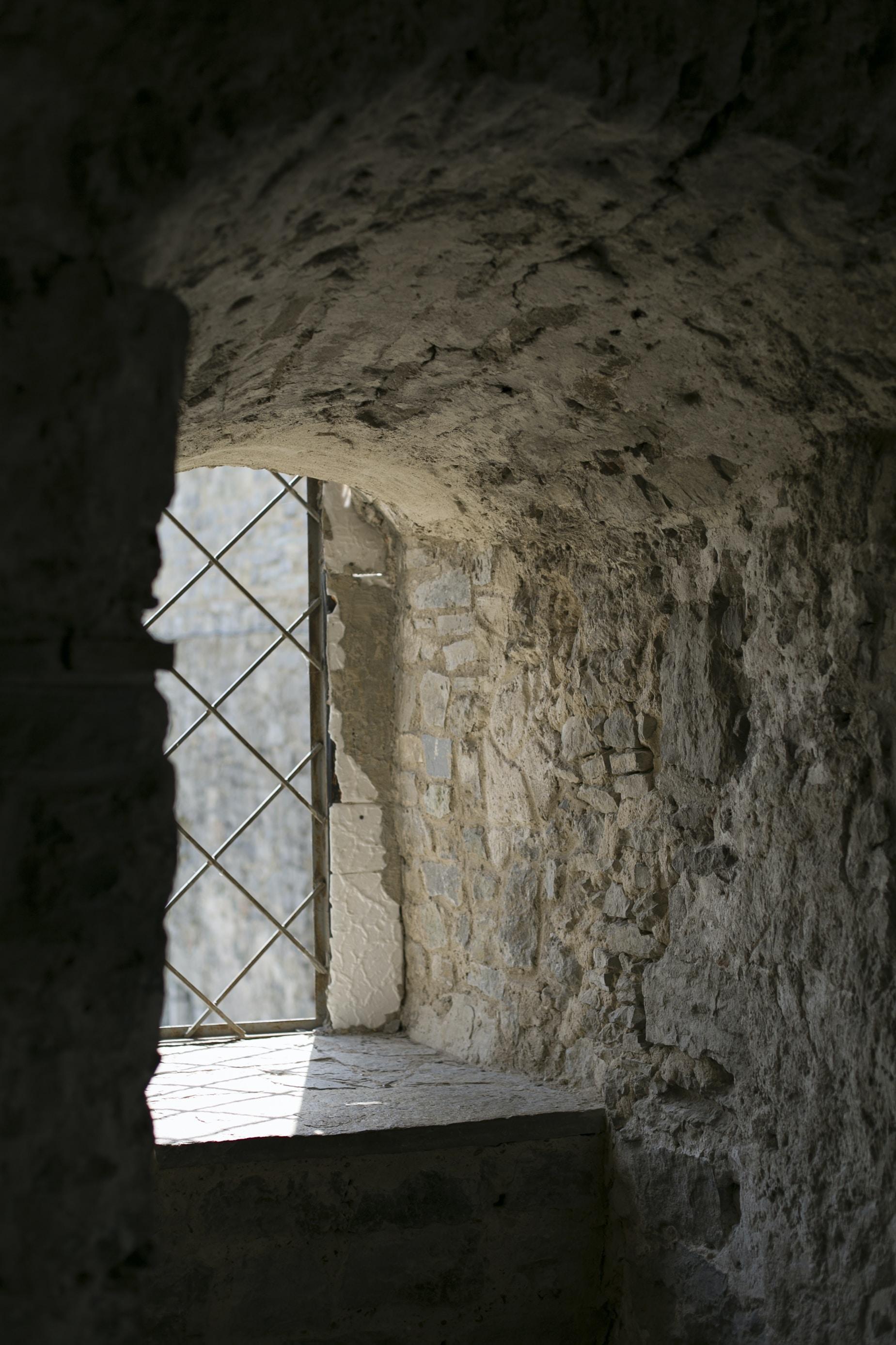 photo of rock house near window