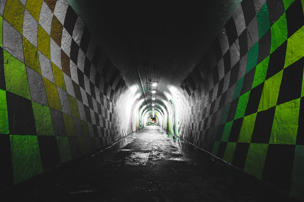 green, black, and white checkered painted tunnel